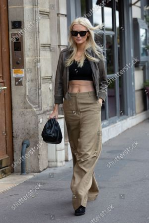 Editorial photo of Street Style, Spring Summer 2022, Paris Fashion Week, France - 04 Oct 2021