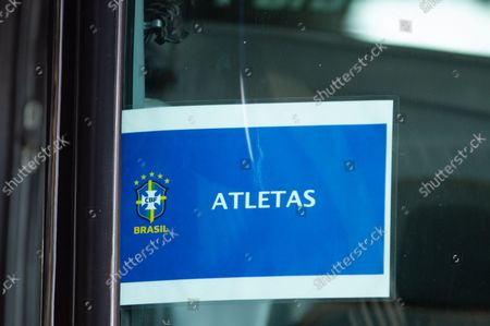A sign that reads 'Athletes' with the Brazil team logo is seen in a bus as members of the Brazil federation of football team board their bus at the Grand Hyatt Hotel in Bogota, Colombia to be transported to the Techo stadium for practice against the qualifying matches between Venezuela and Colombia, on October 4, 2021.