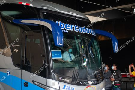 A bus with the Brazilian football team members leaves the Grand Hyatt hotel as members of the Brazil federation of football team board their bus at the Grand Hyatt Hotel in Bogota, Colombia to be transported to the Techo stadium for practice against the qualifying matches between Venezuela and Colombia, on October 4, 2021.