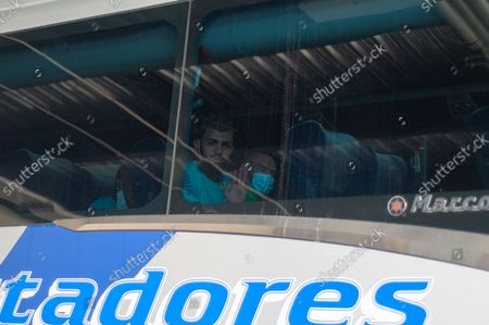 Brazil football team Gabriel Barbosa AKA gabigol looks out from the bus as members of the Brazil federation of football team board their bus at the Grand Hyatt Hotel in Bogota, Colombia to be transported to the Techo stadium for practice against the qualifying matches between Venezuela and Colombia, on October 4, 2021.
