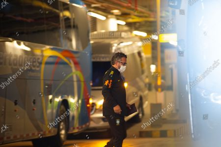 Stock Image of A member of Brazil's national team tecnical comission boards a bus as members of the Brazil federation of football team board their bus at the Grand Hyatt Hotel in Bogota, Colombia to be transported to the Techo stadium for practice against the qualifying matches between Venezuela and Colombia, on October 4, 2021.