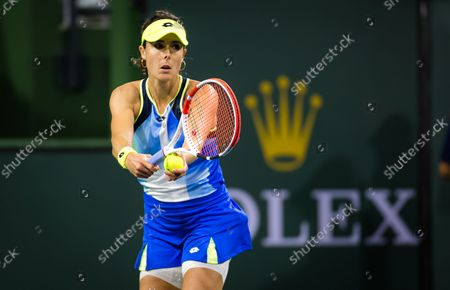 Alize Cornet of France in action during the second round of the 2021 BNP Paribas Open WTA 1000 tennis tournament