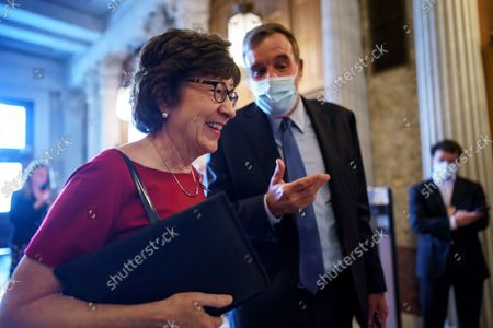 Sen. Susan Collins, R-Maine, left, and Sen. Mark Warner, D-Va., talk as lawmakers rush to the chamber for a confirmation vote, at the Capitol in Washington