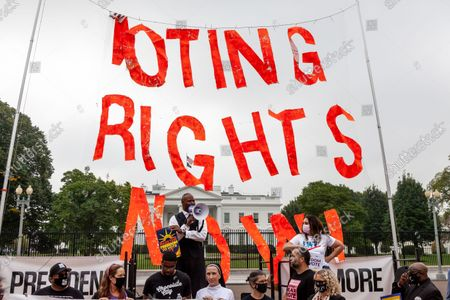 Pastor Lewis Logan of Georgia speaks during a rally demanding that the Biden Administration take the lead on voting rights and pressure Congress to pass legislation protecting the right to vote.