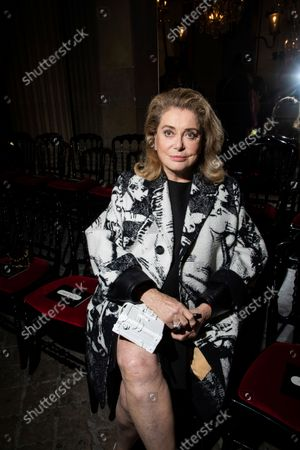 Catherine Deneuve attends the Louis Vuitton Spring-Summer 2022 ready-to-wear fashion show presented in Paris