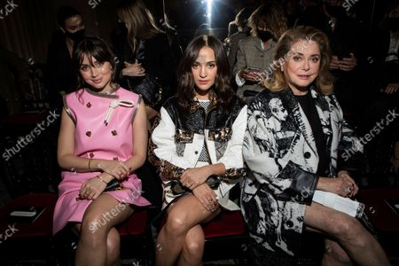 Ana de Armas, from left, Alicia Vikander and Catherine Deneuve attend the Louis Vuitton Spring-Summer 2022 ready-to-wear fashion show presented in Paris