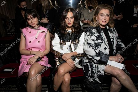 From left, Ana de Armas, Alicia Vikander and Catherine Deneuve attend the Louis Vuitton Spring-Summer 2022 ready-to-wear fashion show presented in Paris