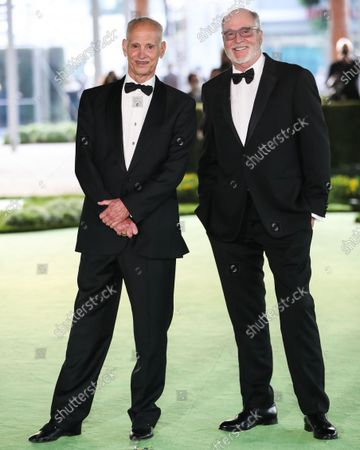 John Waters and Greg Gorman arrive at the Academy Museum of Motion Pictures Opening Gala held at the Academy Museum of Motion Pictures on September 25, 2021 in Los Angeles, California, United States.