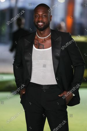 Former professional basketball player Dwyane Wade wearing a Gucci suit and Tiffany & Co. jewelry arrives at the Academy Museum of Motion Pictures Opening Gala held at the Academy Museum of Motion Pictures on September 25, 2021 in Los Angeles, California, United States.