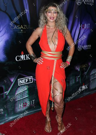 Actress Amber Smith arrives at Karma International's 2019 Kandy Halloween Party on October 19, 2019 in Woodland Hills, Los Angeles, California, United States.