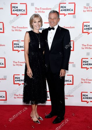 Stock Photo of Corporate honoree Robert Iger, right, and wife Willow Bay attend the 2021 PEN America Literary Gala at the American Museum of Natural History, in New York