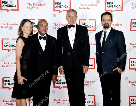 Actress Jodie Foster, left, PEN/Audible Literary Service Award recipient Dr. Henry Louis Gates, PEN Corporate honoree Robert Iger and playwright Lin-Manuel Miranda attend the 2021 PEN America Literary Gala at the American Museum of Natural History, in New York