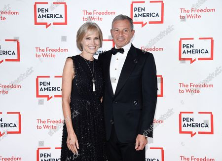 Stock Picture of Corporate honoree Robert Iger, right, and wife Willow Bay attend the 2021 PEN America Literary Gala at the American Museum of Natural History, in New York