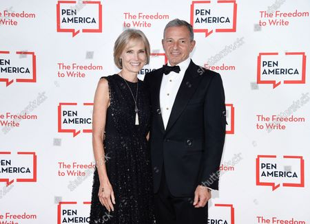 Stock Image of Corporate honoree Robert Iger, right, and wife Willow Bay attend the 2021 PEN America Literary Gala at the American Museum of Natural History, in New York