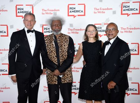 Corporate honoree Robert Iger, left, playwright Wole Soyinka, actress Jodie Foster and PEN/Audible Literary Service Award recipient Dr. Henry Louis Gates pose together at the 2021 PEN America Literary Gala at the American Museum of Natural History, in New York