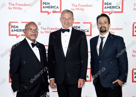 PEN/Audible Literary Service Award recipient Dr. Henry Louis Gates, left, PEN Corporate honoree Robert Iger and playwright Lin-Manuel Miranda attend the 2021 PEN America Literary Gala at the American Museum of Natural History, in New York