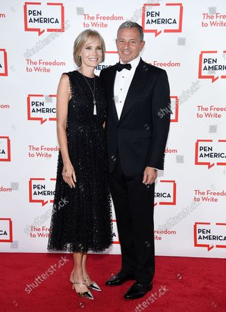 Corporate honoree Robert Iger, right, and wife Willow Bay attend the 2021 PEN America Literary Gala at the American Museum of Natural History, in New York