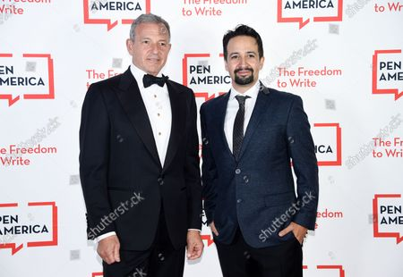 Corporate honoree Robert Iger, left, and Lin-Manuel Miranda attend the 2021 PEN America Literary Gala at the American Museum of Natural History, in New York