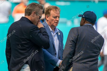 From left, Miami Dolphins Vice Chairman, President and CEO Tom Garfinkel, NFL Commissioner Roger Goodell and Miami Dolphins General Manager Chris Grier talk on the sidelines before the start of an NFL football game against the Indianapolis Colts, in Miami Gardens, Fla