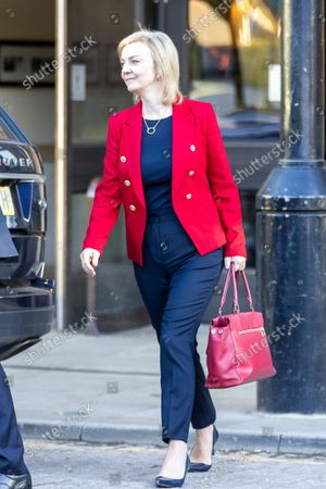 Foreign Secretary Liz Truss leaves the Midland hotel this morning on the fourth & final day of the Conservative Party Conference in Manchester.