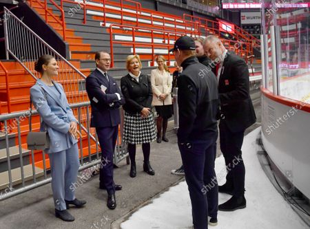Crown Princess Victoria, Prince Daniel and County Governor Maria Larsson meet head coach Niklas Eriksson, Mikael Johansson, Orebro Hockey, and ice hockey player Stefan Warg during their, visit at Behrn Arena, an indoor ice hockey arena, in Orebro, Sweden. The Crown Princess Couple is on a one-day county visit to Orebro