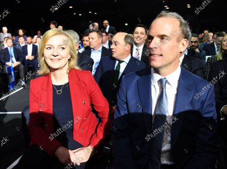 Britain's Foreign Secretary Liz Truss (L) and Justice Secretary Dominic Raab (R) arrive on day four of the Conservative party Conference in Manchester, Britain, 06 October 2021. The Conservative Party conference ends today.