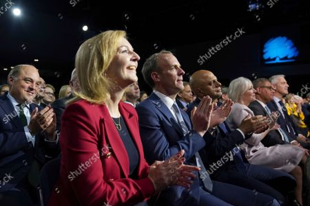 Ben Wallace, left, Britain's Minister of Defence, with Liz Truss the Foreign Secretary and Dominic Raab the Deputy Prime Minister and Said Javid the Health Secretary listen to Britain's Prime Minister Boris Johnson making his keynote speech at the Conservative party conference in Manchester, England