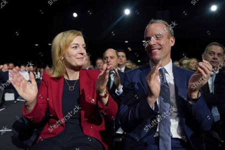 Liz Truss, Britain's Foreign Secretary and Dominic Raab, Deputy Prime Minister, applaud as Britain's Prime Minister Boris Johnson makes his keynote speech at the Conservative party conference in Manchester, England