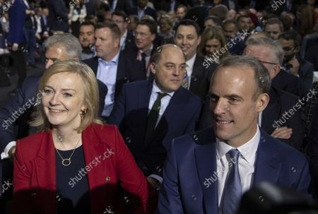 Liz Truss, Foreign Secretary, next to the man she replaced, Dominic Raab, Justice Secretary.Prime Minister, Boris Johnson, gives his speech at the annual Conservative Party Conference.
