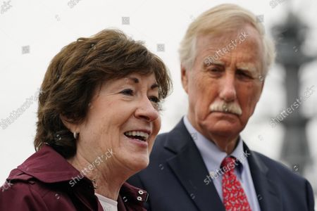 Sen. Susan Collins, R-Maine, speaks to reporters at Bath Iron Works, in Bath, Maine. Sen. Angus King, I-Maine, stands at right