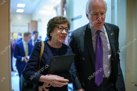 Sen. Susan Collins, R-Maine, left, and Sen. John Cornyn, R-Texas, leave a Republican meeting at the Capitol in Washington, . Senate Republican leader Mitch McConnell has given Democrats a new offer to extend the federal debt ceiling through an emergency short-term extension