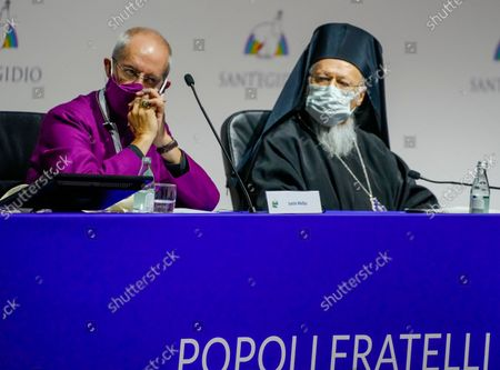 """Archbishop of Canterbury Justin Welby, left, and Ecumenical Patriarch of Constantinople Bartholomew I attend the interreligious meeting 'Brother peoples, future land"""" organized by the Sant'Egidio Community at 'La Nuvola' (the cloud) convention center in Rome"""