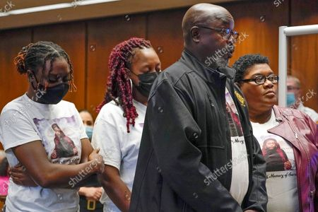 Victor Butler, father of Sarah Butler, stands with family as he gives a victim impact statement during the sentencing for Khalil Wheeler-Weaver in Newark, N.J., . Wheeler-Weaver, a New Jersey man who used dating apps to lure three women, including Sarah Butler, to their deaths and attempted to kill a fourth woman five years ago, was sentenced to 160 years in prison on Wednesday, as he defiantly proclaimed his innocence