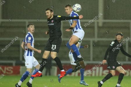 Ryan Cooney of Morecambe and David Ferguson of Hartlepool United in action during the EFL Trophy match between Hartlepool United and Morecambe at Victoria Park, Hartlepool on Tuesday 5th October 2021.