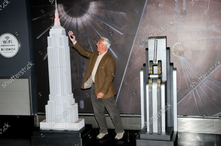 """Bobby Valentine marvels at the lit model of the Empire State Building. Former New York Mets baseball player and manager, Stamford mayoral candidate, Bobby Valentine visits the Empire State Building to honor """"Answer The Call"""" NYPD & NYFD Children's Benefit Fund, in New York City."""