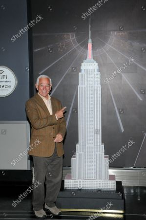 """Bobby Valentine poses for photos during the lighting ceremony. Former New York Mets baseball player and manager, Stamford mayoral candidate, Bobby Valentine visits the Empire State Building to honor """"Answer The Call"""" NYPD & NYFD Children's Benefit Fund, in New York City."""