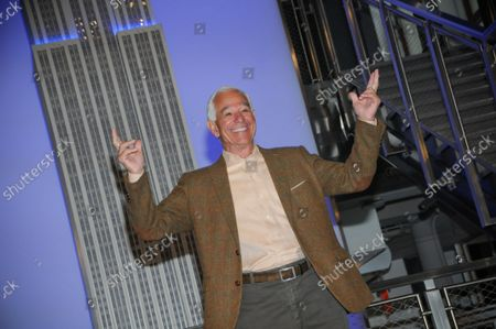 """Bobby Valentine enthusiastically poses for photos at the Grand Staircase. Former New York Mets baseball player and manager, Stamford mayoral candidate, Bobby Valentine visits the Empire State Building to honor """"Answer The Call"""" NYPD & NYFD Children's Benefit Fund, in New York City."""