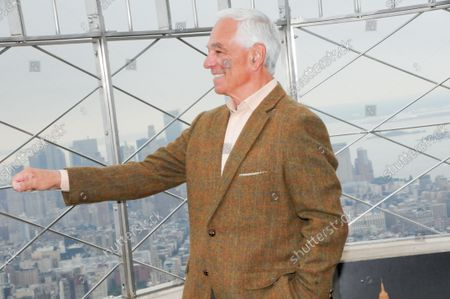 """Bobby Valentine poses for photos at the 86th floor observatory of the Empire State Building. Former New York Mets baseball player and manager, Stamford mayoral candidate, Bobby Valentine visits the Empire State Building to honor """"Answer The Call"""" NYPD & NYFD Children's Benefit Fund, in New York City."""