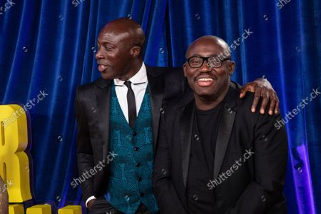 Edward Enninful and Ozwald Boateng pose for photographers upon arrival at the opening of the London film festival and the World premiere of the film 'The Harder They Fall' in London