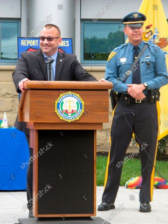 Stock Photo of David D'Amico, chief investigator with the Middlesex County Department of Corrections, left, and Lt. John Hayes of the New Jersey State Police, right, speak at a news conference in Freehold N.J. announcing an outreach program to the LGBTQ community, including a program where victims of bias crimes can seek temporary shelter in local businesses while waiting for authorities to arrive