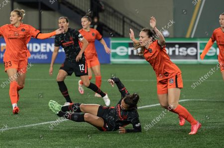 Sophia Smith (9 Portland Thorns) going down in the box during the National Womens Soccer League game between Portland Thorns v Houston Dash at Providence Park in Portland, Oregon