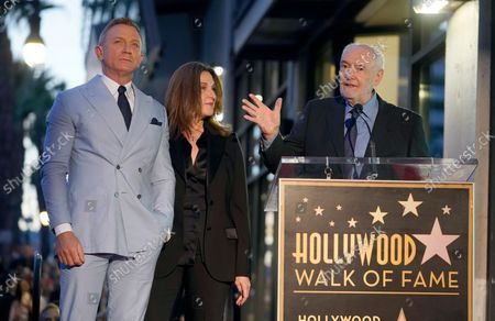 Michael G. Wilson, from right, speaks as Barbara Broccoli and Daniel Craig look on during a ceremony honoring Craig with a star on the Hollywood Walk of Fame, in Los Angeles