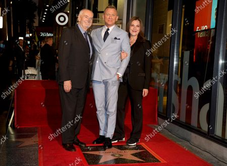 Daniel Craig, center, poses atop his new star on the Hollywood Walk of Fame with Michael G. Wilson, left, and Barbara Broccoli during a ceremony in Craig's honor, in Los Angeles