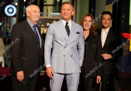 Daniel Craig, third right, poses with Michael G. Wilson, from left, Barbara Broccoli and Rami Malek following a ceremony honoring Craig with a star on the Hollywood Walk of Fame, in Los Angeles