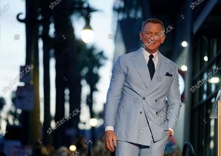 Actor Daniel Craig smiles from the stage during a ceremony to award him a star on the Hollywood Walk of Fame, in Los Angeles