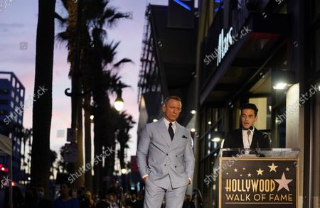 Actor Daniel Craig, left, looks on as guest speaker Rami Malek delivers a speech during a ceremony to award Craig a star on the Hollywood Walk of Fame, in Los Angeles