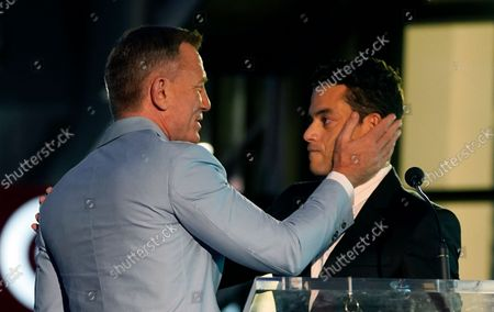 Actor Daniel Craig, left, thanks guest speaker Rami Malek during a ceremony to award Craig a star on the Hollywood Walk of Fame, in Los Angeles