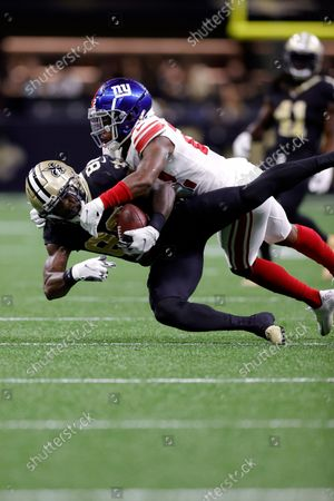 New Orleans Saints wide receiver Ty Montgomery (88) is tackled by New York Giants cornerback Adoree' Jackson (22) during an NFL football game, in New Orleans