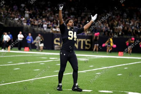 New Orleans Saints defensive end Cameron Jordan (94) gestures to the crowd before an NFL football game against the New York Giants, in New Orleans