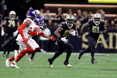 New Orleans Saints wide receiver Ty Montgomery (88) runs past New York Giants cornerback Adoree' Jackson (22) during an NFL football game, in New Orleans